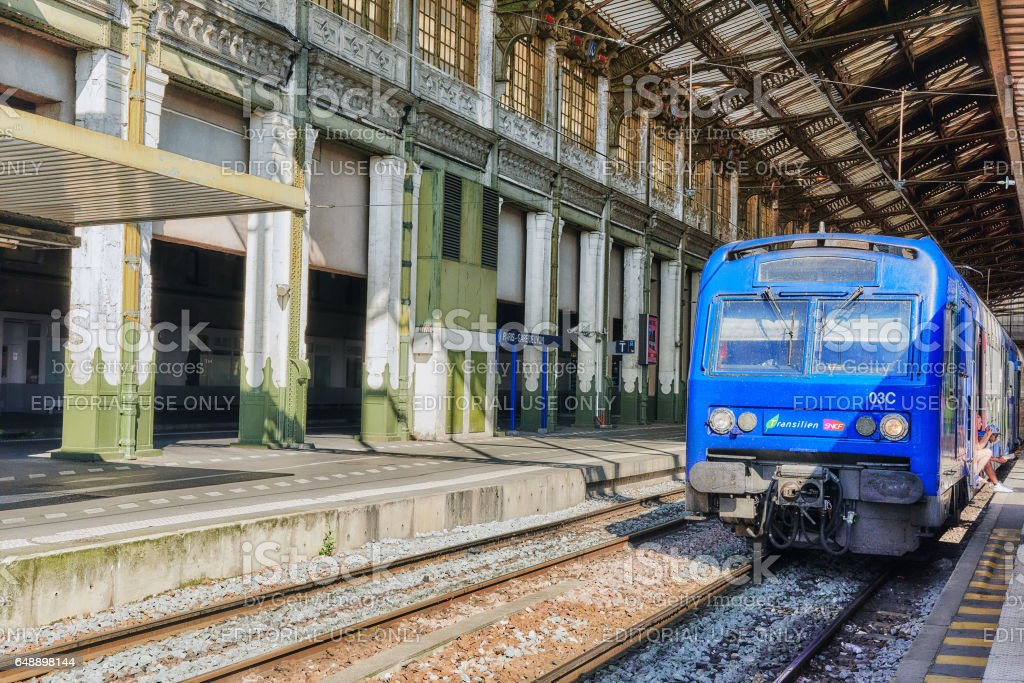 Commuter train at the North Railways station(Gare de Nord). Commuter train is comfortable, speed and most convenience in France. stock photo