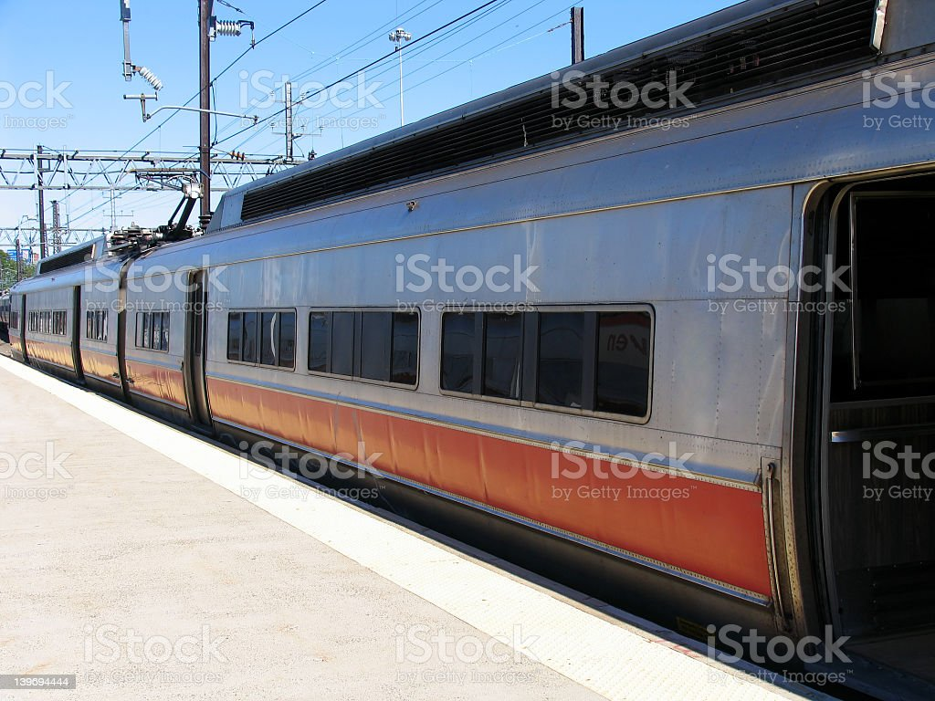 Commuter Train Waiting at Station royalty-free stock photo