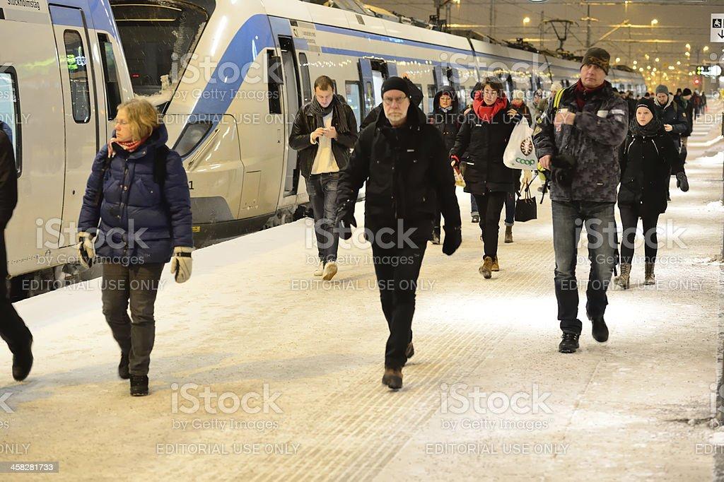 Commuter train waiting at winter platform royalty-free stock photo