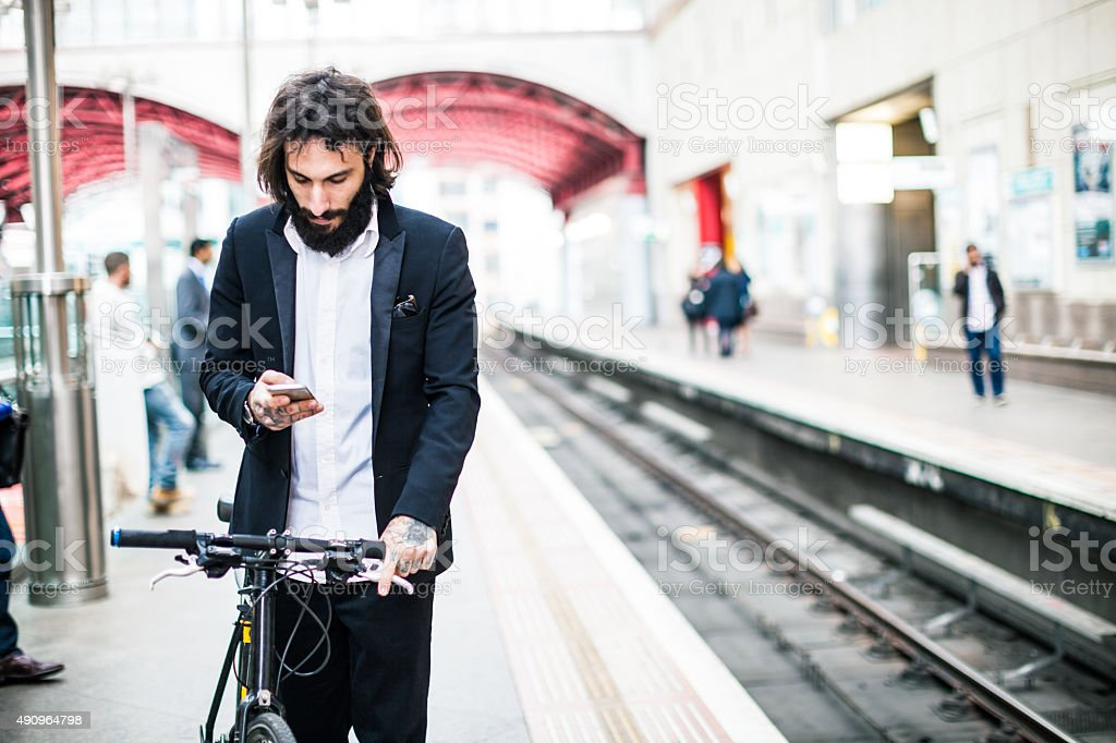 Commuter waiting the train with his bicycle stock photo