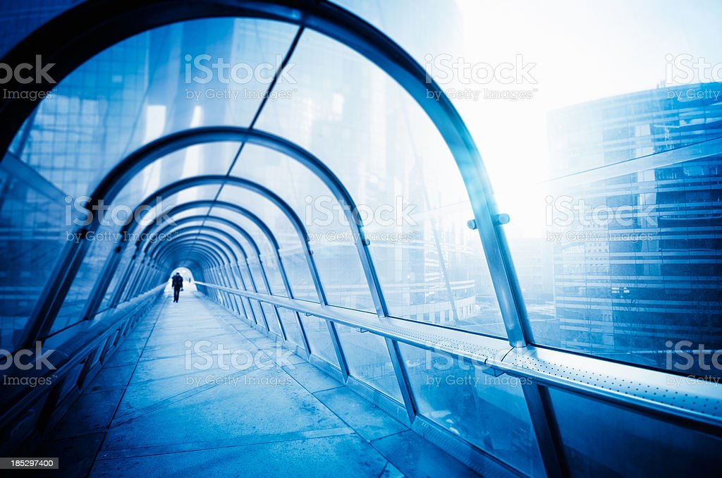 Commuter walking on the tunnel in Paris financial district royalty-free stock photo