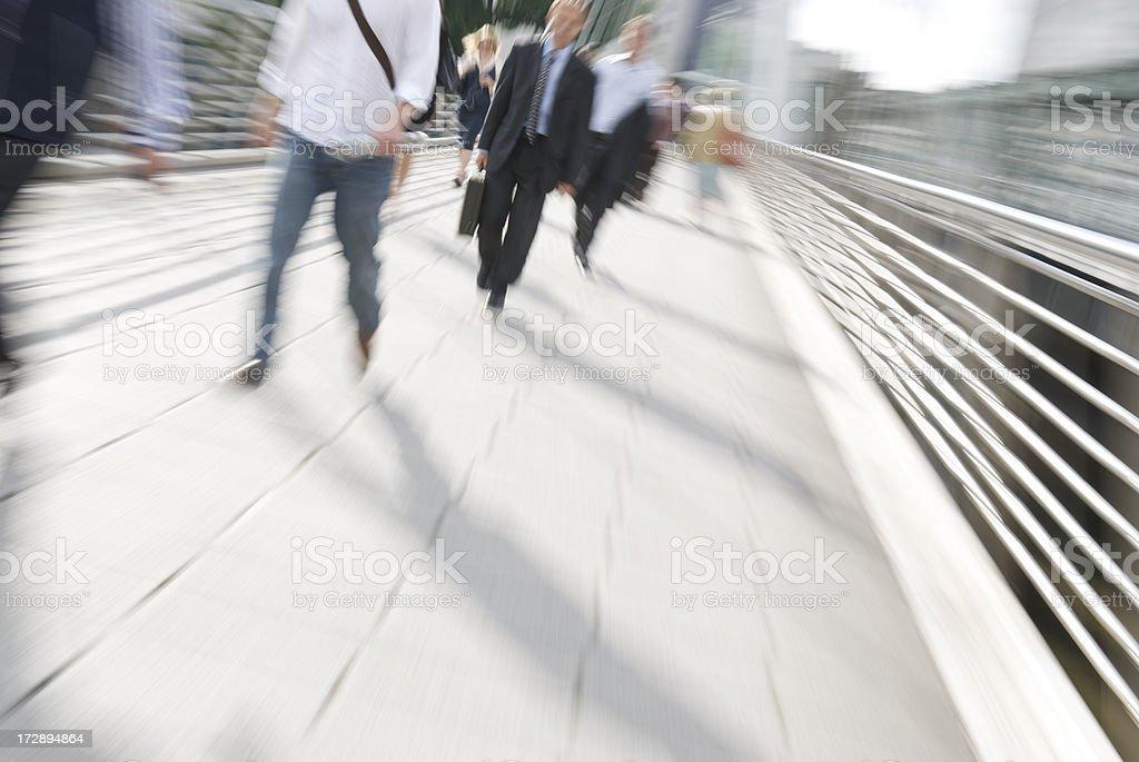 Commuter Zoom on Pedestrian Bridge London stock photo