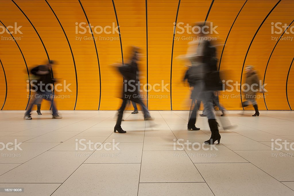 commuters against modern orange background stock photo