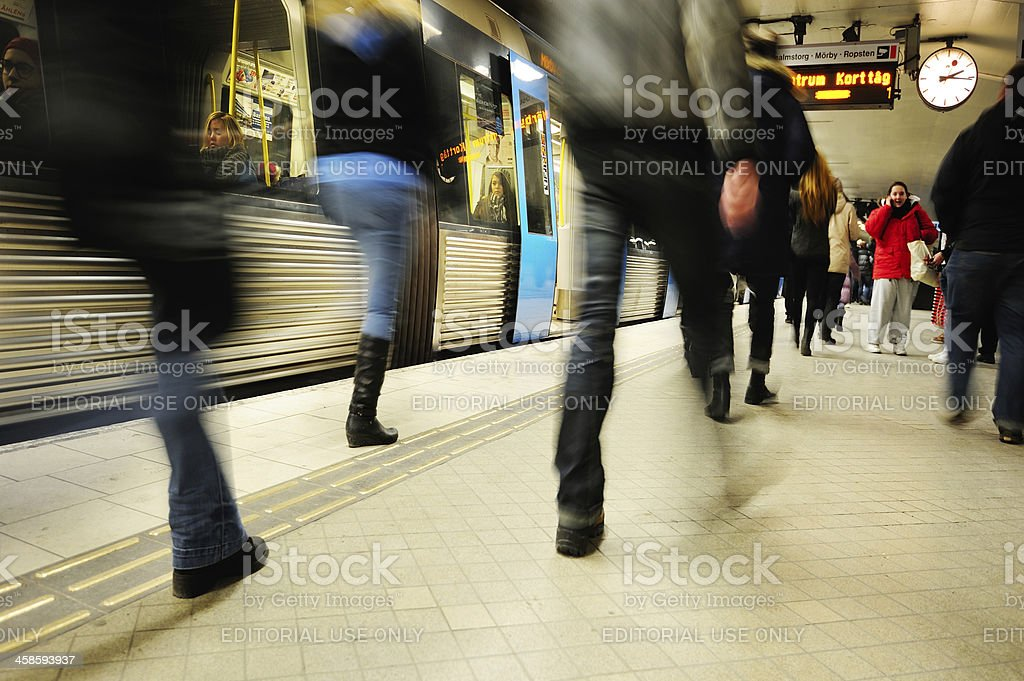 Commuters and subway train royalty-free stock photo