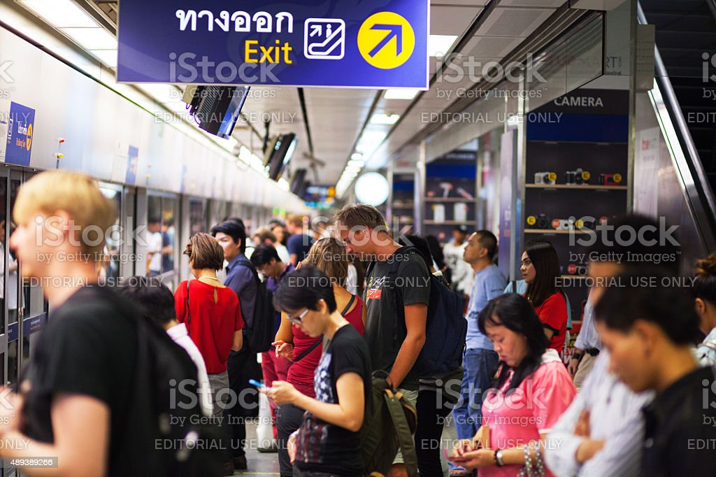 Commuters and tourists in MRT station stock photo