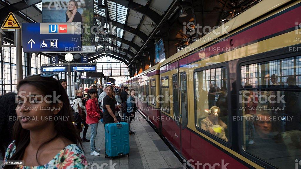 Commuters at Berlin Friedrichstrasse Station in Berlin, Germany stock photo