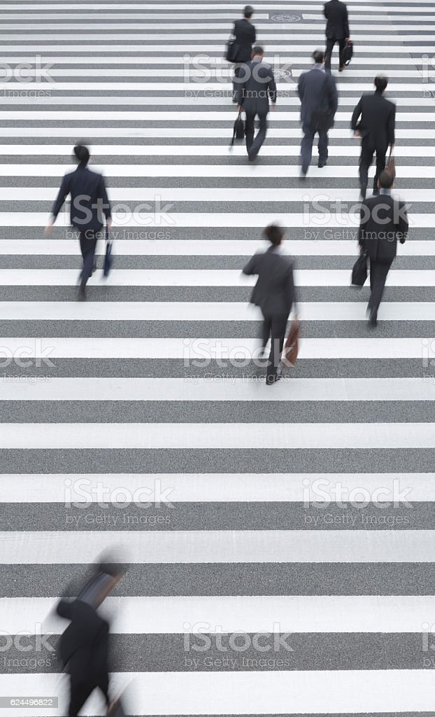 Commuters at Crosswalk in the Morning stock photo