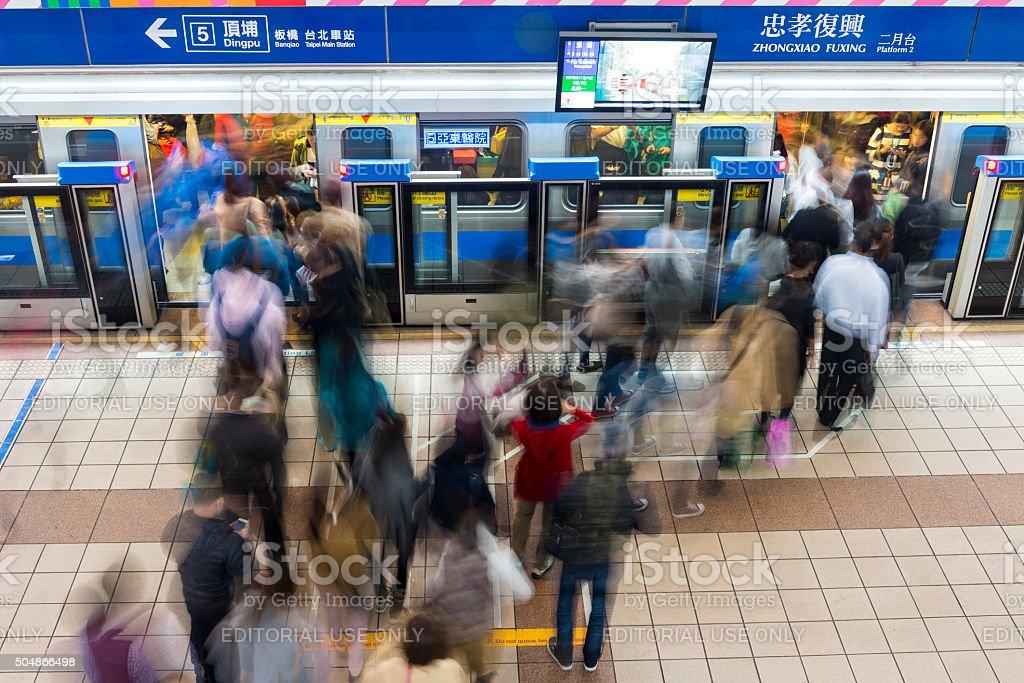 Commuters boarding Taipei MRT subway stock photo