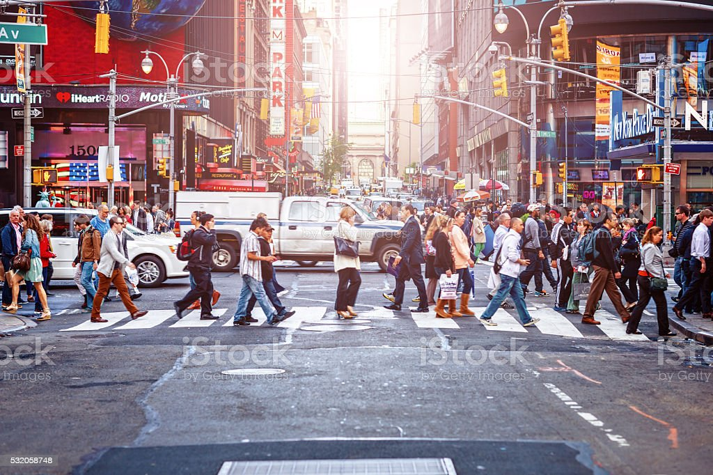 Commuters crossing 43rd Street in New York City, USA stock photo