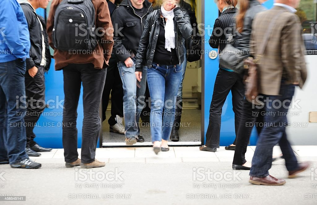 Commuters entering and exiting subway train royalty-free stock photo