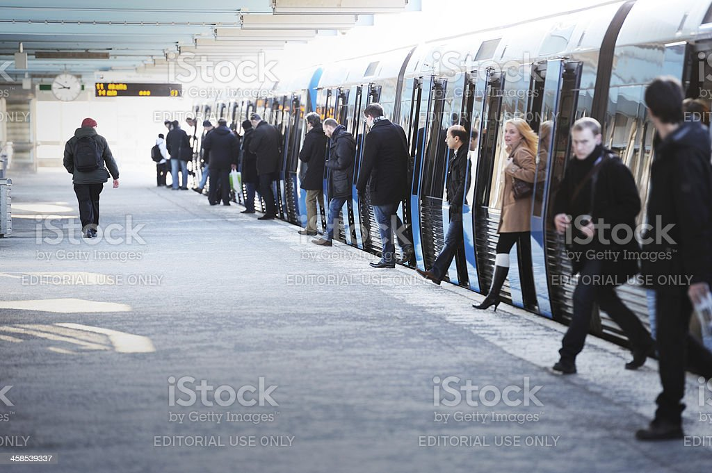 Commuters exiting subway train royalty-free stock photo