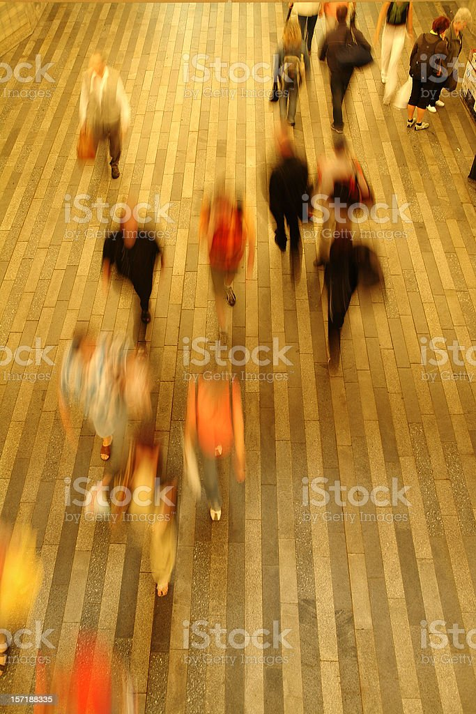 Commuters in a hurry on striped surface royalty-free stock photo