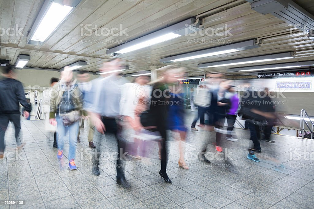 Commuters in corridor of a subway station, Manhattan, New York stock photo