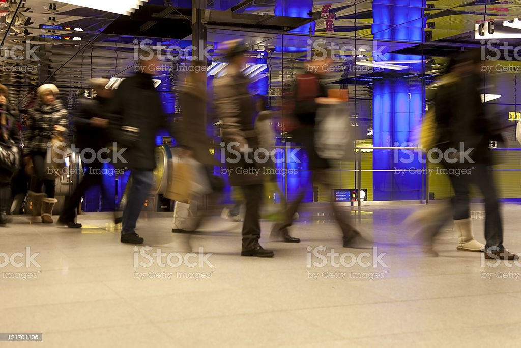 commuters in hurry at modern underground with copy space royalty-free stock photo