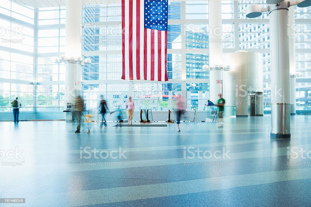 Commuters in Modern Building stock photo