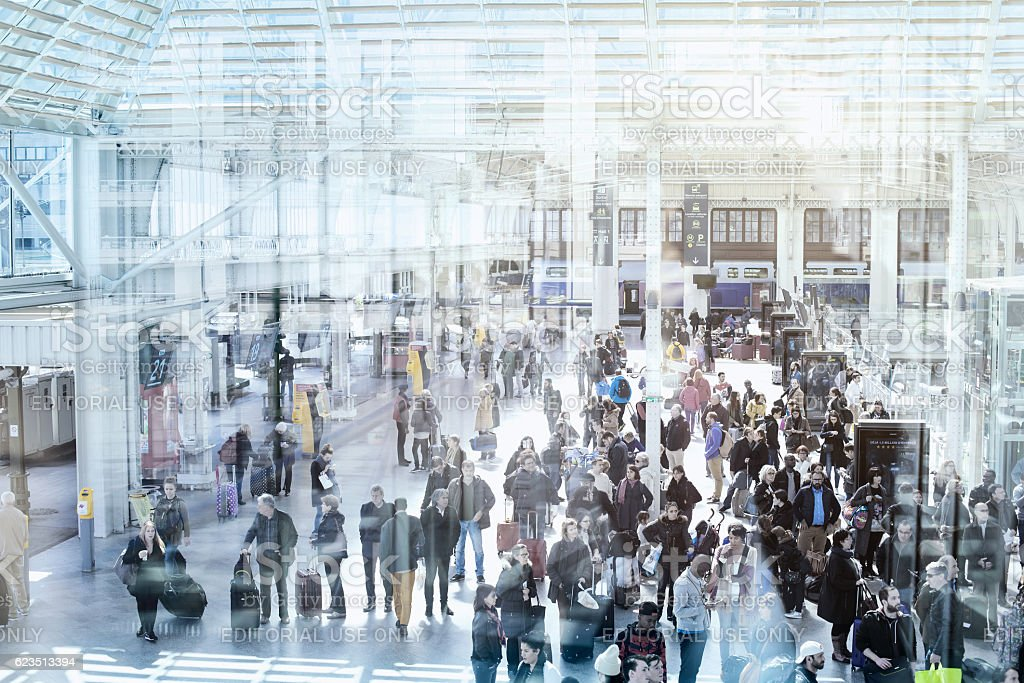 Commuters in modern train station stock photo