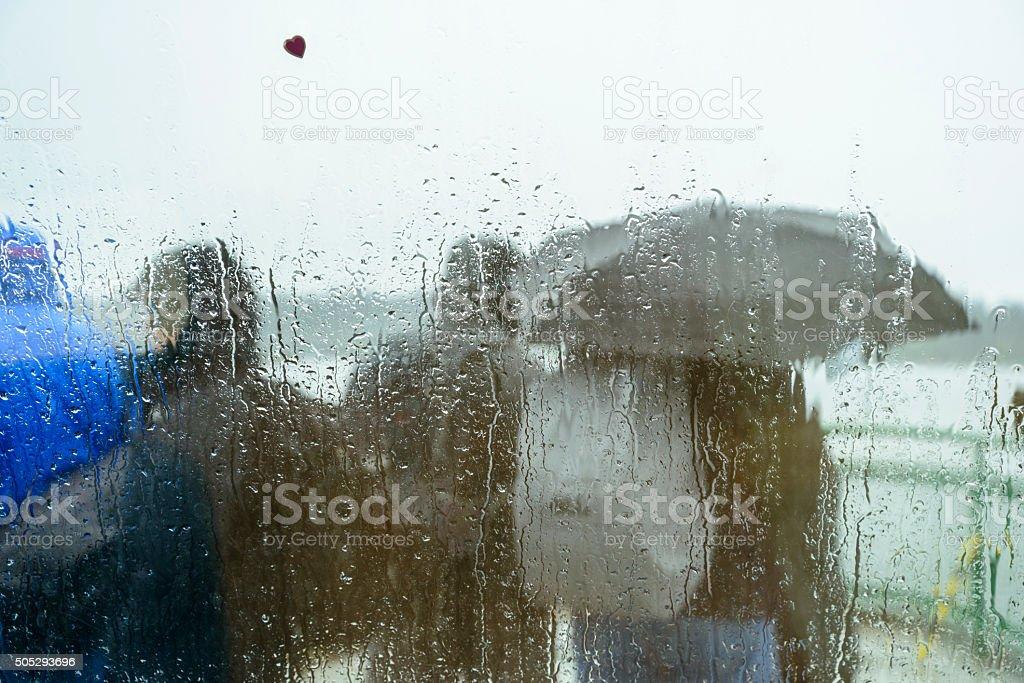 Commuters in rain with umbrella stock photo