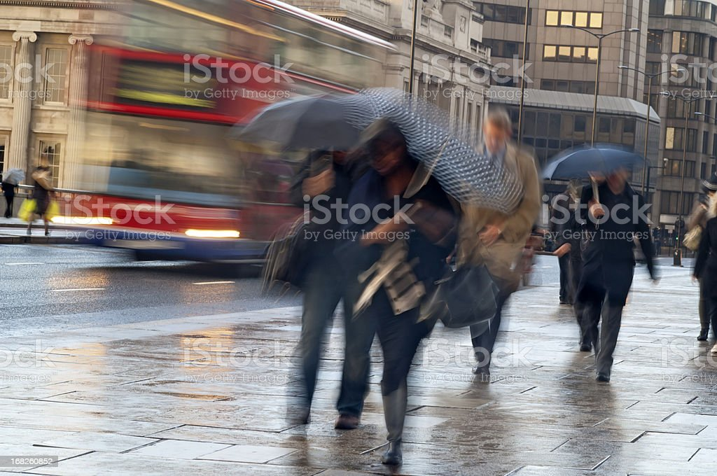 Commuters in the Rain in London with movement blur stock photo