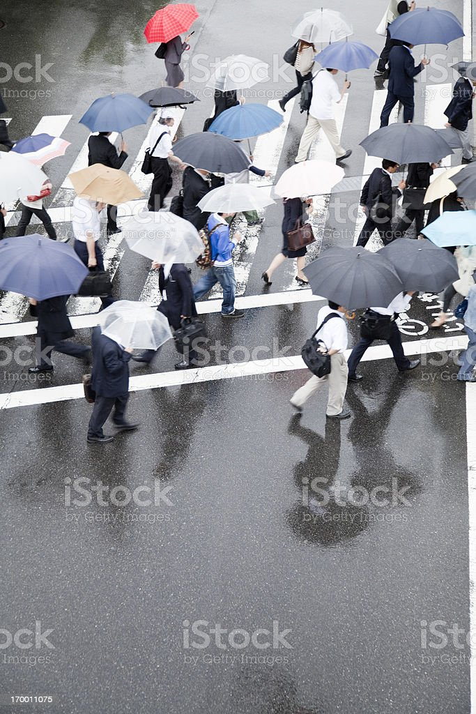 Commuters on a rainy day royalty-free stock photo