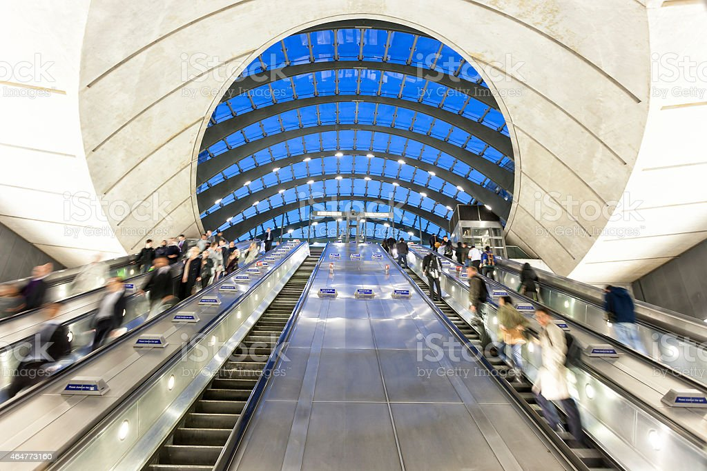 Commuters on Escalators Descending into Subway Station, London, England stock photo