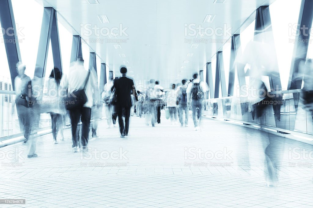 Commuters on the Move in Walkway Motion Blur royalty-free stock photo