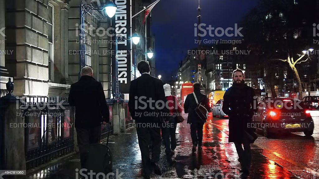 Commuters on The Strand in the Evening stock photo