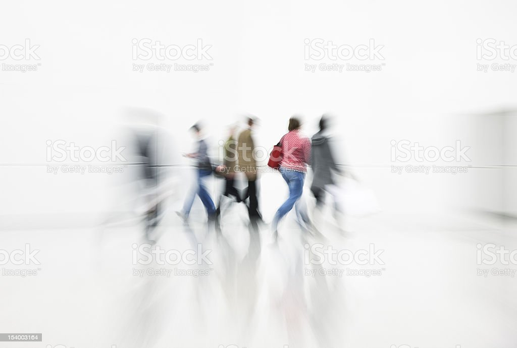 Commuters Rushing in White Interior, Blurred Motion stock photo