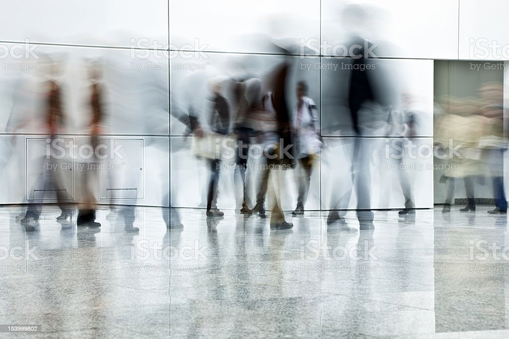 Commuters Walking in Corridor, Blurred Motion royalty-free stock photo