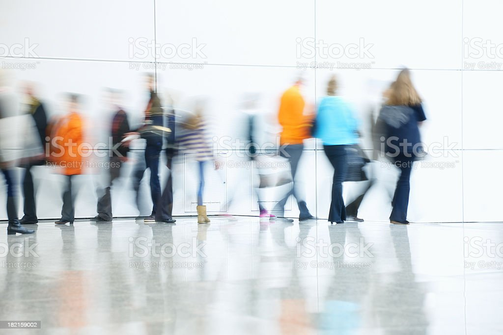 Commuters Walking in Corridor, Blurred Motion stock photo
