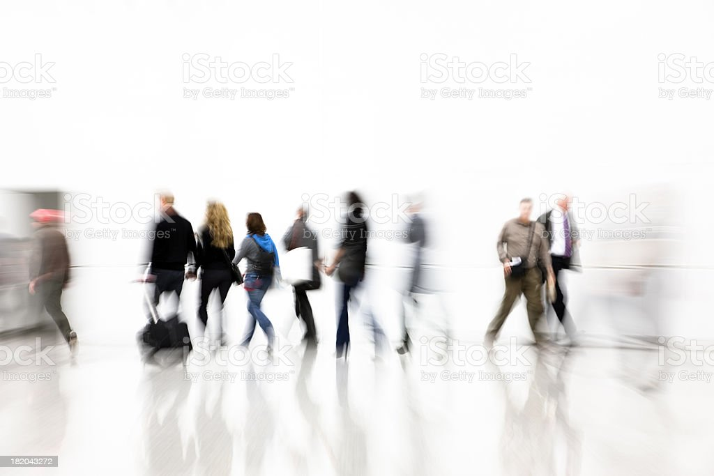 Commuters Walking in Corridor, Pulling Luggage, Blurred Motion royalty-free stock photo