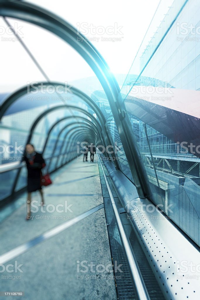 Commuters Walking inside Futuristic Connection Tunnel royalty-free stock photo