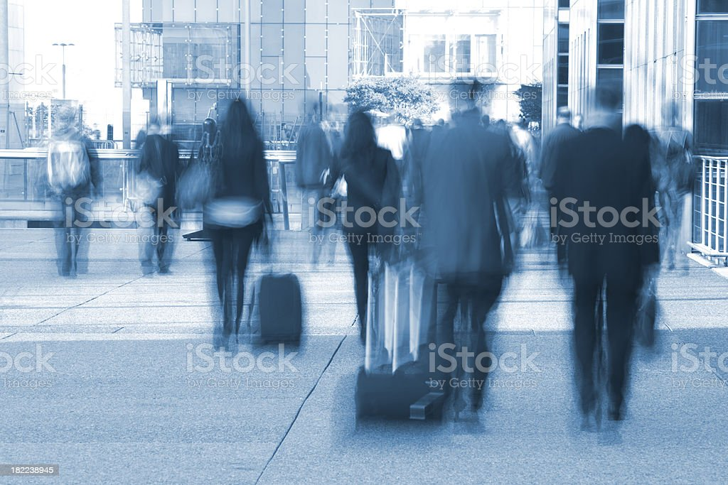 Commuters walking to subway station, blurred motion royalty-free stock photo