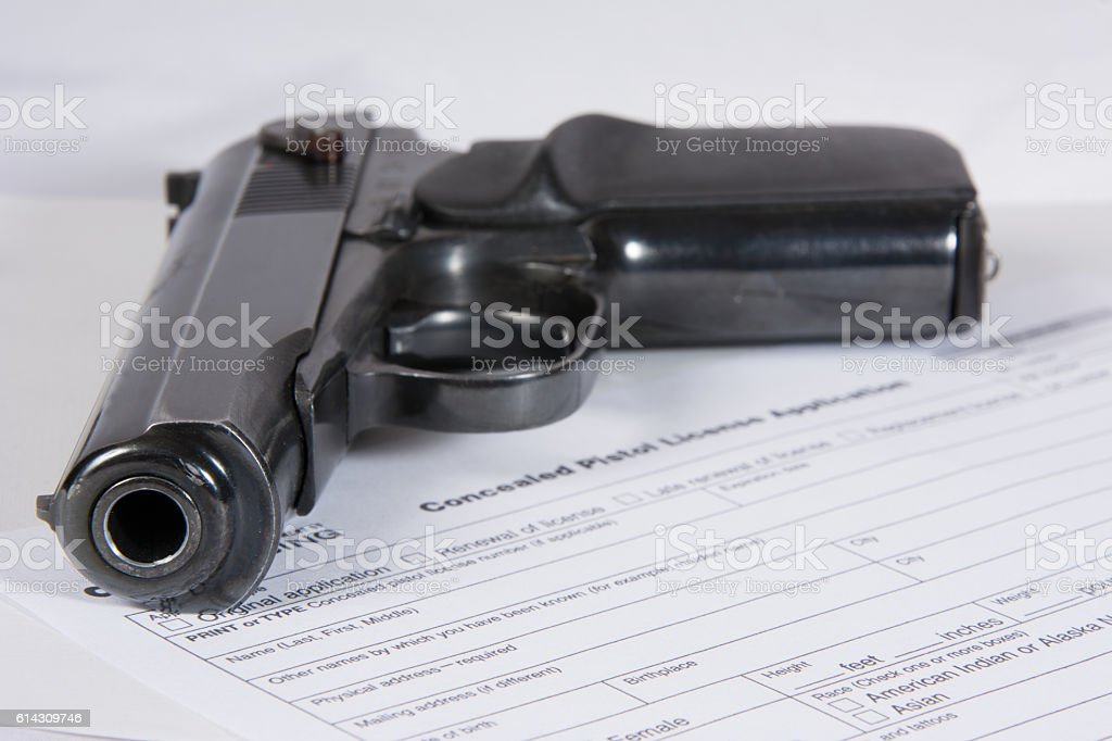 Compact 9mm Pistol with application for license stock photo