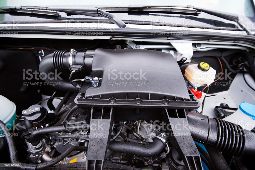 Compact and powerful diesel engine of small cargo van stock photo