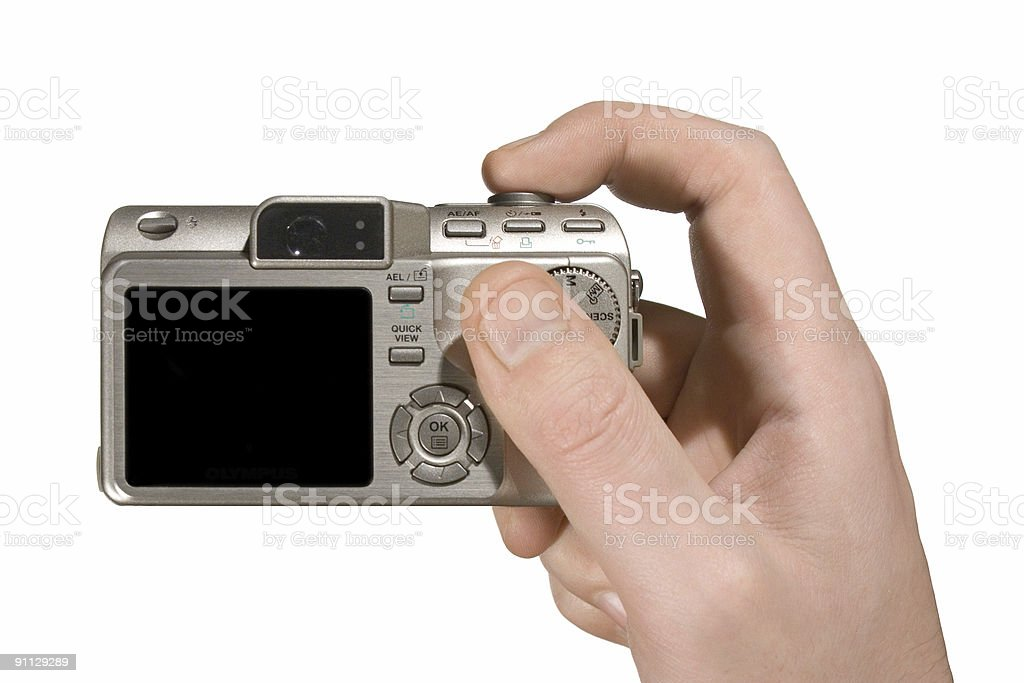 Compact camera in hand stock photo
