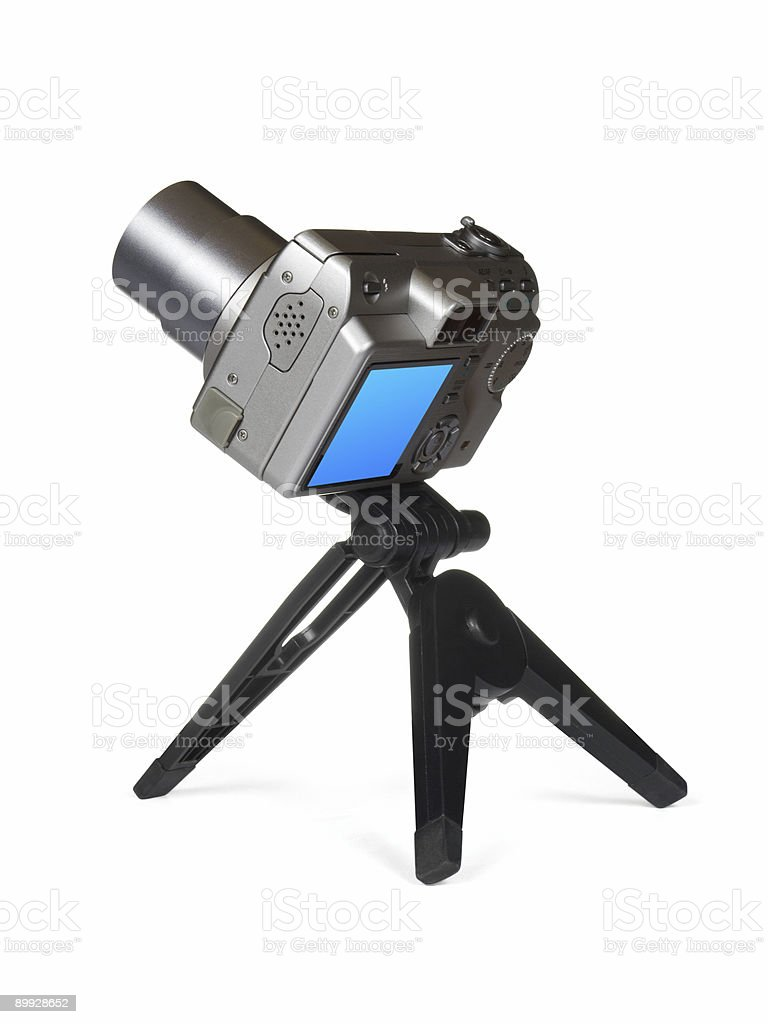 Compact camera on tripod royalty-free stock photo