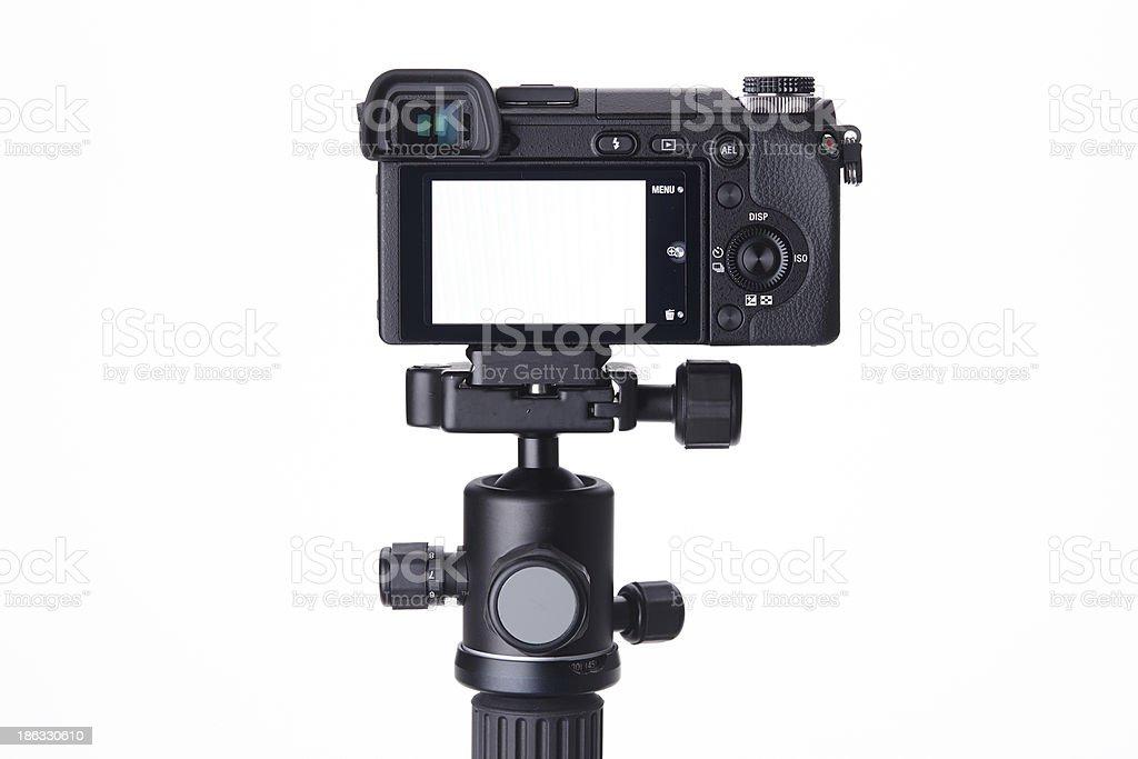 Compact digital camera on mini tripod stock photo