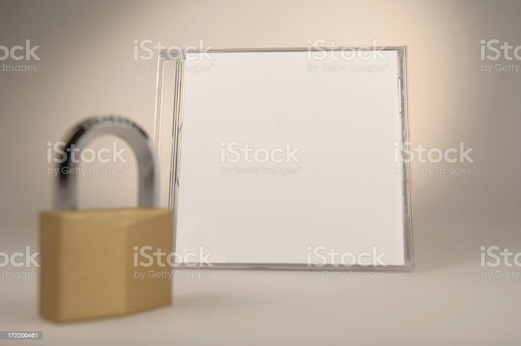compact disc case with lock in foreground royalty-free stock photo