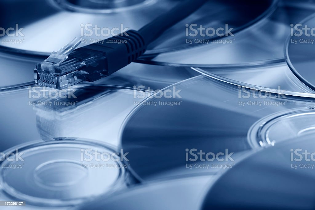 Compact discs and network royalty-free stock photo