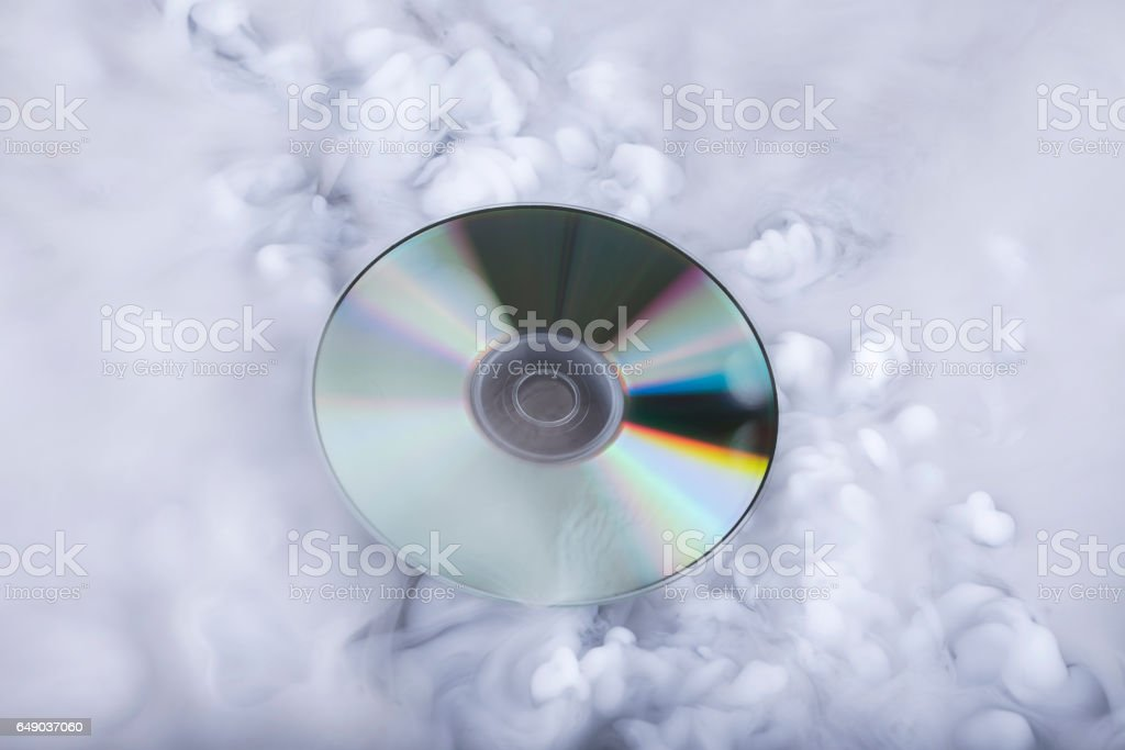 Compact disk in the clouds. Conceptual image. Sound cloud stock photo