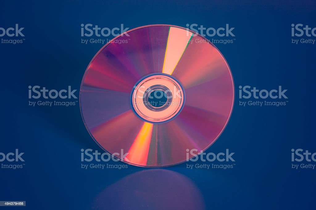 Compact disk on blue background stock photo