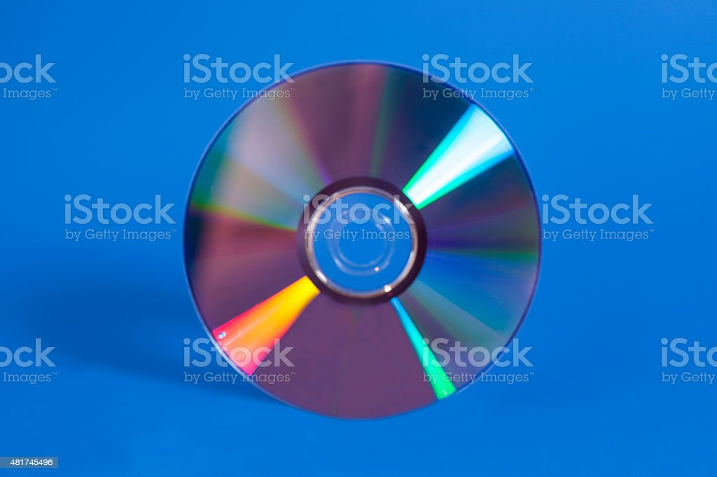 Compact disk on blue stock photo