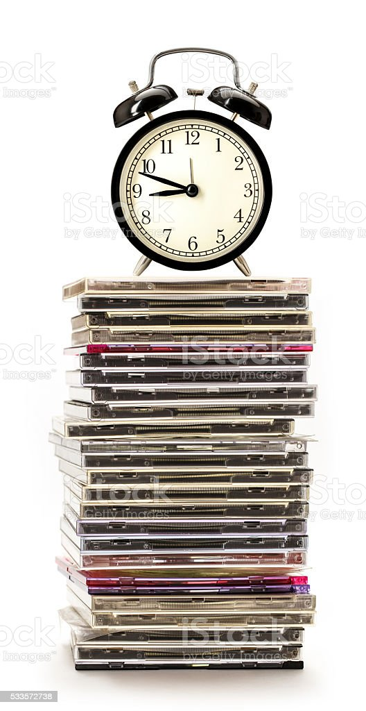 Compact disks with alarm clock stock photo