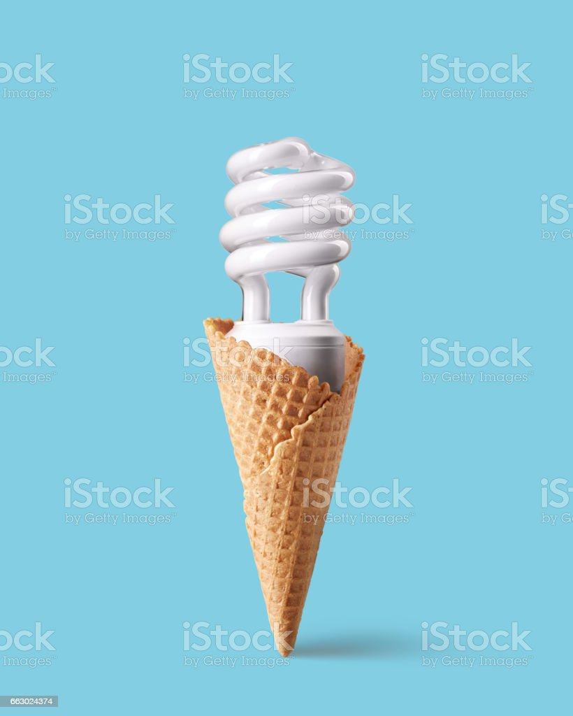 Compact fluorescent bulb in ice cream cone stock photo