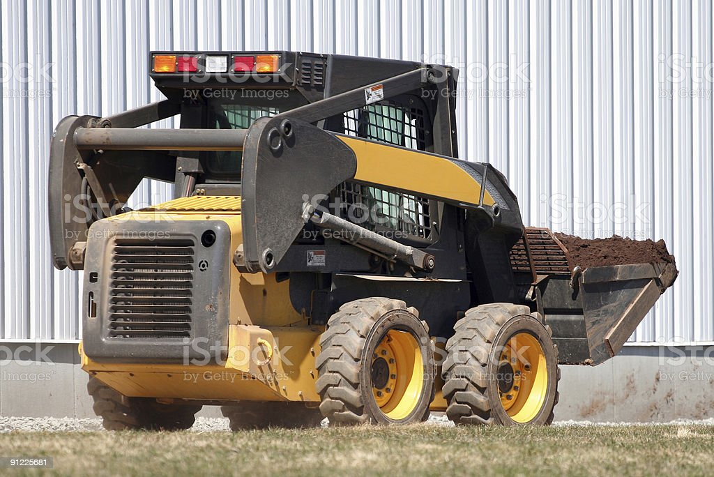 Compact Loader - 2 stock photo