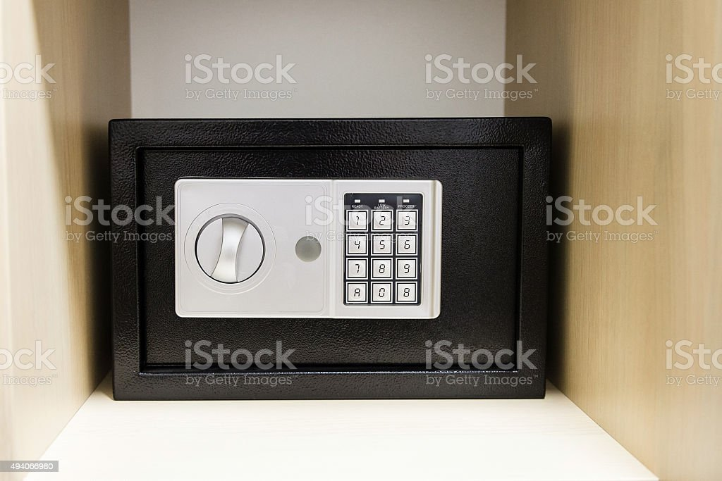 compact safe on shelf of cabinet stock photo