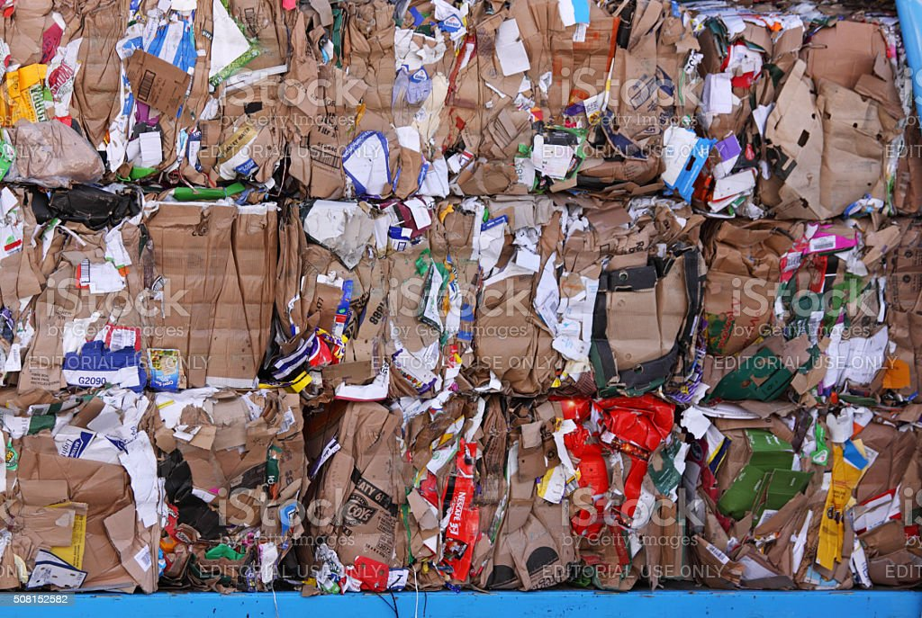 Compacted cardboard prior to processing at a recycling plant stock photo