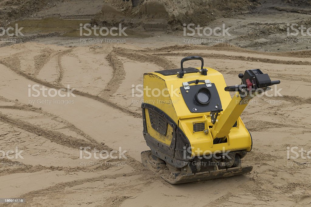 Compaction of sand before the construction  road stock photo