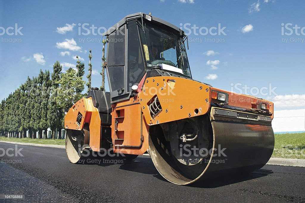Compactor at asphalt pavement works (wide angle) stock photo
