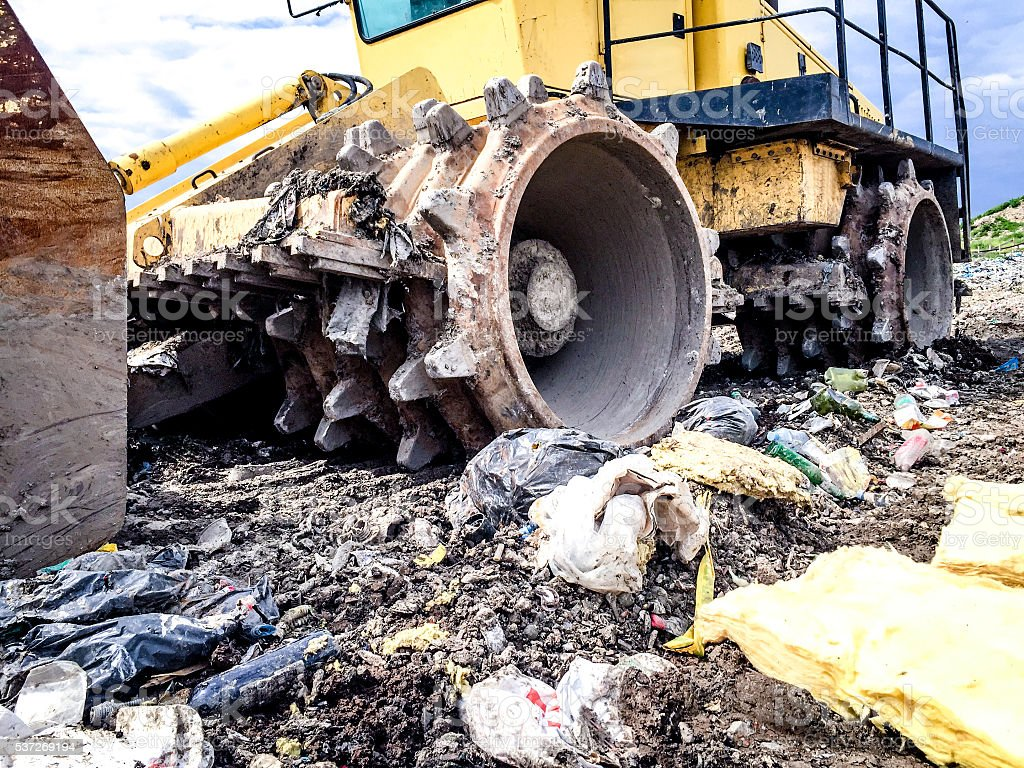 Compactor in landfill stock photo